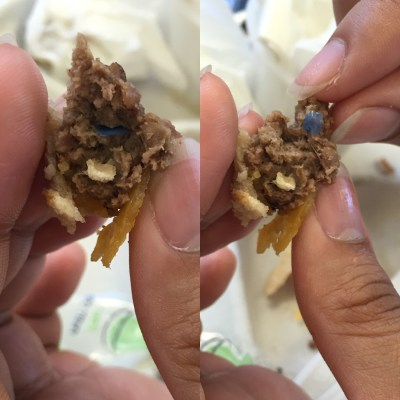 A hamburger patty that appears to have plastic pallets inside of it served by Aramark to students in a Chicago school. The students started a website in 2015 to document Aramark's food quality. | Photo courtesy The School Lunch Project