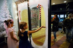 Participants take photos and video of the window display at Twisted Cookie. | Alexa Rogals/Staff Photographer