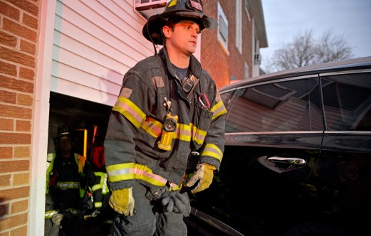 A Forest Park firefighter exits the apartment complex on Wednesday, Dec. 20, 2017, on the 500 block of Jackson Boulevard in Forest Park, Ill. (Alexa Rogals | Staff Photographer)