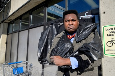 The Bedrock movement's limited budget forces founder John Netherly to get creative in how he serves the homeless by repurposing trash bags into windbreakers, which he models here. | Alexa Rogals/Staff Photographer
