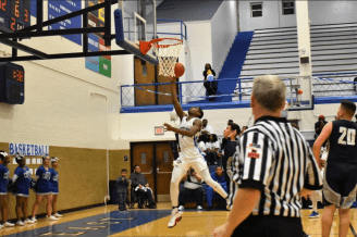 Proviso East Pirate, Quinlan Bennett flys to the basket against Addison Trail Blazers for the victory. | Courtesy Jill Wagner