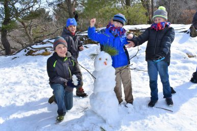 Scouts, a snowman and an mini snowman at a lookout at Starved Rock State Park. | Courtesy Jill Wagner