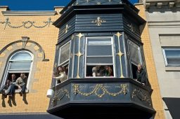 Residents watch the parade line from their windows. | Alexa Rogals/Staff Photographer