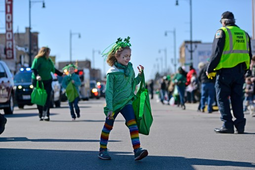 A parade participant hands out candy to attendees. | Alexa Rogals/Staff Photographer