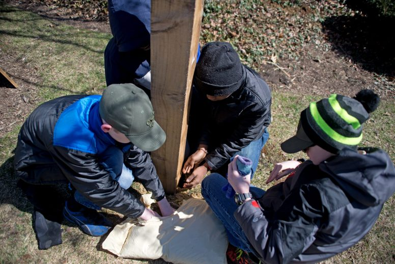 Boy Scouts secure the post of their mini-food pantry in front of the Forest Park Public Library. | Alexa Rogals/Staff Photographer