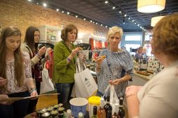 Some participants mingle and try appetizers to pair with the wine inside Jayne clothing store. | Alexa Rogals/Staff Photographer