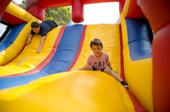 Students play on the inflatable slides.   Alexa Rogals/Staff Photographer