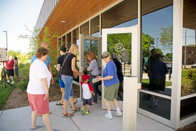 Attendees enter through the front doors during the grand opening of the Roos Recreation Center. Saturday, May 26, during the grand opening of the Roos Recreation Center on Harrison Street in Forest Park. | Alexa Rogals/Staff Photographer