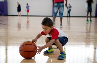 Adrian Hussain, 2, of Forest Park, plays with a basketball. | Alexa Rogals/Staff Photographer