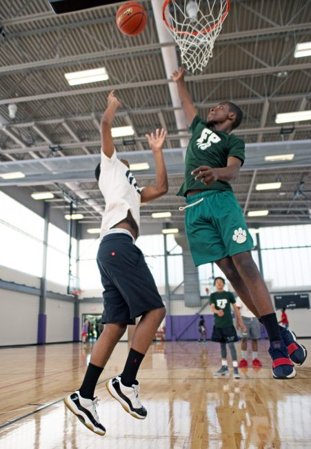Forest Park residents try out the new gymnasium and play basketball. | Alexa Rogals/Staff Photographer