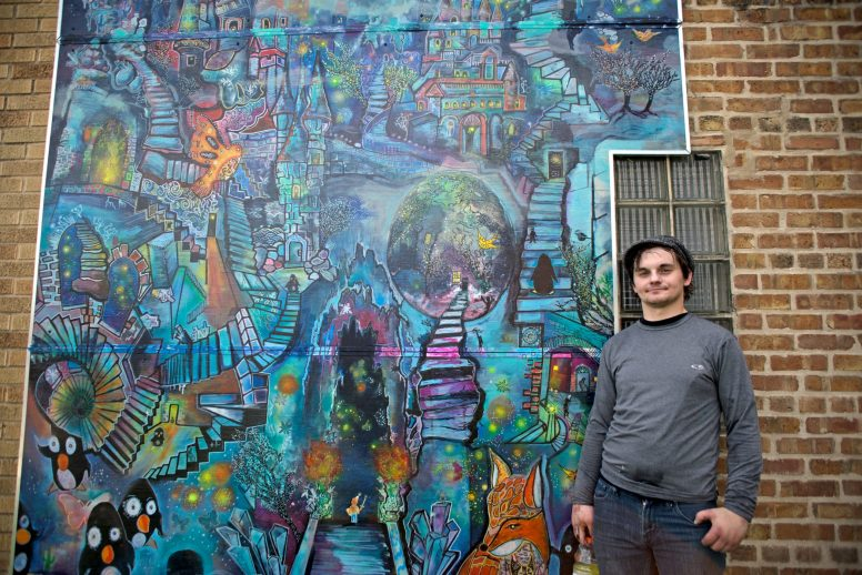 Artist David Wilinski stands next to the mural he painted on the wall facing East on Thursday, May 31, at Nadeau's Ice House on Roosevelt Road in Forest Park. | Alexa Rogals/Staff Photographer