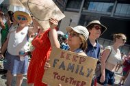 Forest Park resident Rina Petersen holds a sign during the Families Belong Together rally and march at the Richard J. Daley Center in downtown Chicago. | Alexa Rogals/Staff Photographer