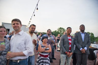 Attendees enjoy appetizers and drinks while listening to speakers on Wednesday, June 27, during a D209 Fundraiser for Proviso East High School scholarships on the rooftop of Urban Pioneer Group in Forest Park. | Alexa Rogals/Staff Photographer
