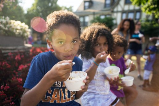 From left, Jewan Garner, 8, Mallory Doxie, 6 and Luke Garner eat ice cream sundaes together on Friday, July 13, during the free ice cream social at the Park District of Forest Park on Harrison Street. | Alexa Rogals/Staff Photographer