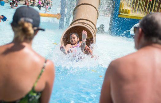 Kids cool off on the children's slide. | Alexa Rogals/Staff Photographer