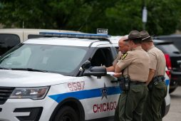 Illinois State police officers talk with a Chicago Police officer on Wednesday, Aug. 29, 2018, in the parking lot at the United States Postal Service building on Garfield Street near Harlem Avenue in Oak Park, Ill. (ALEXA ROGALS/ Staff Photographer)
