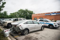 A Chicago Police vehicle blocks in a totaled silver Hyundai Sonata on Wednesday, Aug. 29, 2018, in the parking lot at the United States Postal Service building on Garfield Street near Harlem Avenue in Oak Park, Ill. (ALEXA ROGALS/ Staff Photographer)