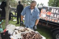 Marlon Burlock, from Boss Pigs BBQ, cuts on rib samples on Saturday, Sept. 8, 2018, during the annual Rib Fest at Picnic Grove in Forest Park. | Alexa Rogals/Staff Photographer