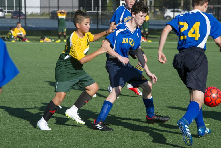 Forest Park Middle School's Milo Gittings (#13) races to the ball on Thursday, Sept. 13, during a co-ed soccer game against at Veterans Field at the Park District of Forest Park on Harrison Street. | Alexa Rogals/Staff Photographer