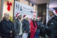 Christmas Carolers outside of the Progress Center sing. | Alexa Rogals/Staff Photographer