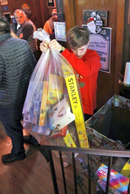 Jordan McCotter,18, of Oak Park, empties a box of donated toys (Sarah Minor/Contributor)