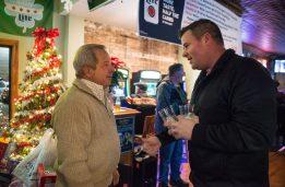 Forest Park Mayor Anthony Calderone, left, talks with resident Jeff Aschenbach. | Alexa Rogals/Staff Photographer
