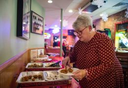 Sandy Byrnes tries out the food. | Alexa Rogals/Staff Photographer