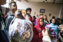 Seventh-graders from Forest Park Middle School bring in bags filled with hand-made blankets to donate. | Alexa Rogals/Staff Photographer
