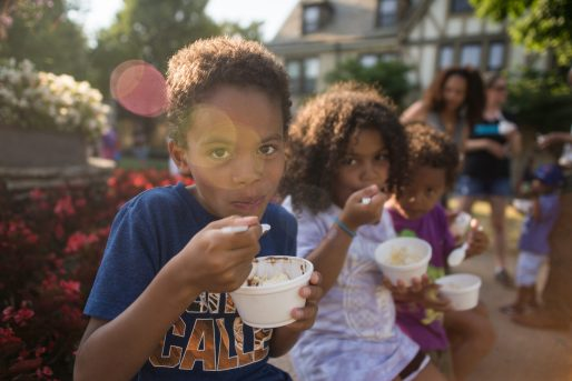 From left, Jewan Garner, 8, Mallory Doxie, 6 and Luke Garner eat ice cream sundaes together on Friday, July 13, 2018, during the free ice cream social at the Park District of Forest Park on Harrison Street. | Alexa Rogals/Staff Photographer