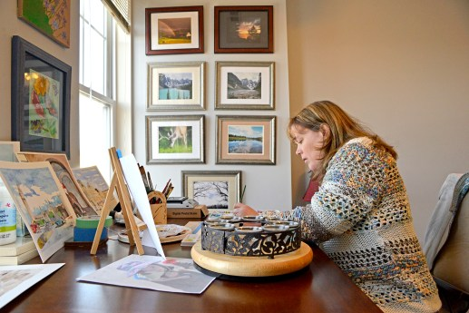 Heather Kadlec, of Forest Park, paints a picture of her niece on Thursday, Jan. 18, 2018, inside her studio at her home in Forest Park. | Alexa Rogals/Staff Photographer