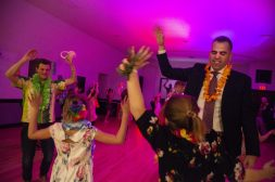 A group of kids and dads dance together on Friday, Feb. 1, during the Hawaiian Luau Daddy Daughter Dance at the Park District of Forest Park. | Alexa Rogals/Staff Photographer