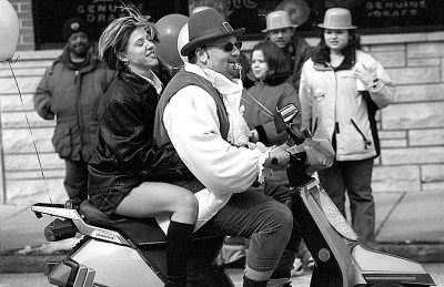 Bob Marani and a companion rode in the parade on a motor scooter