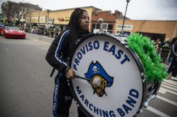 Members of the Proviso East High School marching band perform for parade goers during the annual Forest Park St. Patrick's Day Parade on Madison Street throughout downtown Forest Park. | Alexa Rogals/Staff Photographer