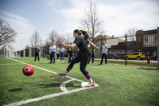 A player from the adults team kicks the ball during the WE Day Charity Kickball Game at Veterans Park in Forest Park. | Alexa Rogals/Staff Photographer