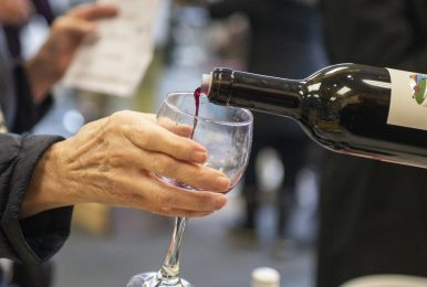 Guests sample the Ninety Plus Cellars merlot on April 27, during the annual Spring Wine Walk and Shop on Madison Street throughout downtown Forest Park. | ALEXA ROGALS/Staff Photographer
