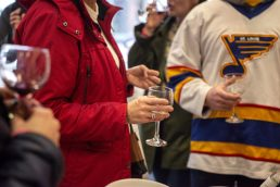 Guests sample different types of wine during the annual Spring Wine Walk and Shop on Madison Street throughout downtown Forest Park last Saturday. | ALEXA ROGALS/Staff Photographer
