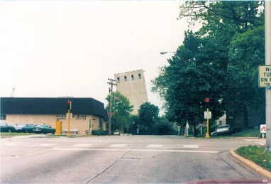 This view from Des Plaines and Jackson shows the Acme grain tower leaning from the powerful force of the wrecking ball. The towers, which were built in the 1920's, were built to last, and took days to come down.