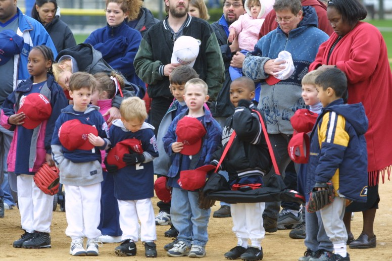 Little League teams gather for the opening ceremonies of the 2002 season.