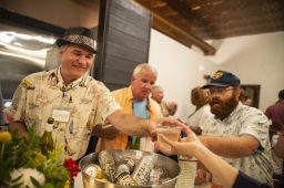 Roy Sansone, left, serves drinks during the Great Chefs for Success fundraiser for District 209 Together at Urban Pioneer Group on Madison Street in downtown Forest Park. | Alexa Rogals/Staff Photographer