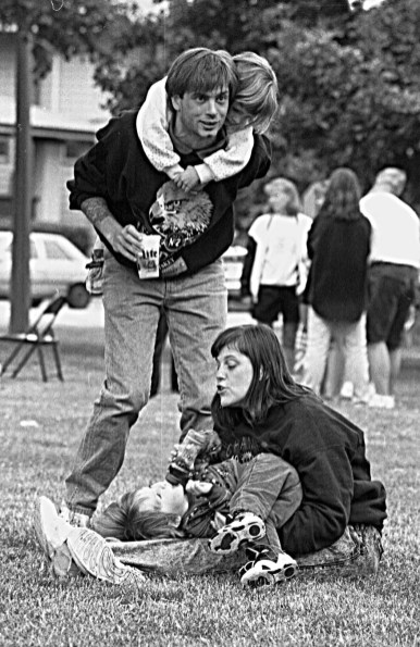 Ray McConnaughay with daughter Amanda on his back and Barbara and little Stephen, at the park with the whole family.