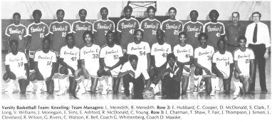 Varsity Basketball Team: Kneeling: Team Managers: L. Meredith, B. Meredith. Row 2: E. Hubbard, C.Cooper, D. McDonald, S. Clark, T. Long, V. Williams, J. Monegain, E. Sims, E. Ashford, R. McDonald, C. Young. Row 3: L. Chatman, T. Shaw, T. Fair, J. Thompson, J. Simon, L. Cleveland, R. Wilson, G. Rivers, C. Watson, K. Bell , Coach G. Whittenberg, Coach D. Maaske