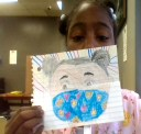 D91 student Ma'Leah displays her artwork for Emily Bruzzini's class. | Photo submitted