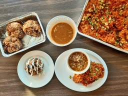 Shanahans offers several family meals. The option shown here serves four and includes shrimp and sausage jambalaya, a quart of Chicken Gumbo (an upgrade) and bread pudding with vanilla sauce.