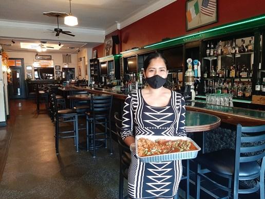 Shanahan's manager, Esthela Gonzalez, shows off their shrimp and sausage jambalaya for four.