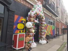 Enjoy the gingerbread house made from balloons that graces Kribi Coffee at the corner of Madison Street and Circle Avenue. | Maria Maxham