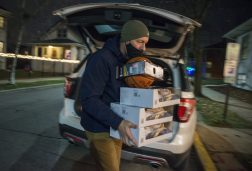 Resident Rob Sall balances boxes of toys for the toy drive on Dec. 18. | Alex Rogals, Staff Photographer