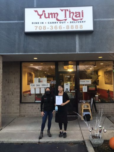 Susie Goldschmidt (left) visited Yum Thai, 7748 Madison St., as part of Byline Bank's plan to purchase 5,000 in gift certificates from local restaurants | Photo provided