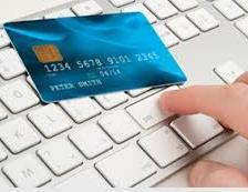 blue credit card on a keyboard