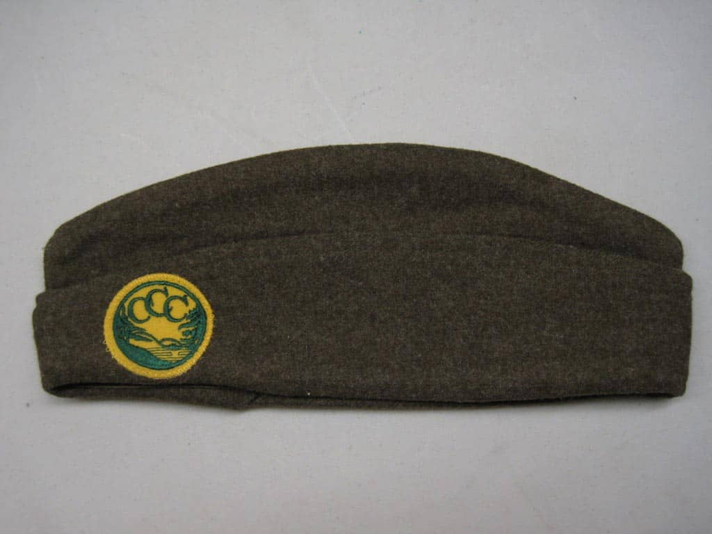 A Civilian Conservation Corps cap, formally known as an overseas garrison cap, c. 1939. All recruits were issued military-style uniforms: shirt, pants, tie, boots, and cap.