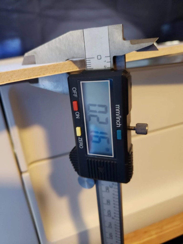Calipers measuring the width of material